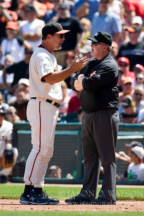 April 25, 2010; San Francisco, CA, USA;  San Francisco Giants manager Bruce Bochy (15) argues with first base umpire Bill Miller during the fourth inning at AT&T Park. St. Louis defeated San Francisco 2-0.
