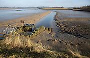 Drainage sluice at low tide Kirton Creek, River Deben, Hemley, Suffolk, England, UK