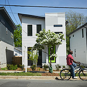 RALEIGH, NC - APRIL 18: In the neighborhoods off Blount Street in Raleigh, NC, residents can find themselves riding past 1940's bungelow style homes next to new modern construction on the same street on Thursday  April 18, 2019. (Photo by Logan Cyrus for The New York Times)