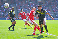 Oliver Norburn of Shrewsbury Town (29) and Jordan Williams of Barnsley (22) in action during the EFL Sky Bet League 1 match between Barnsley and Shrewsbury Town at Oakwell, Barnsley, England on 19 April 2019.