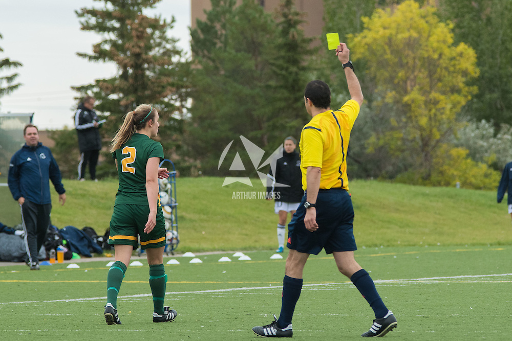 2nd year forward Kirsten Finley (2) of the Regina Cougars receives a yellow card during the Women's Soccer home game on September 11 at U of R Field. Credit: Arthur Ward/Arthur Images