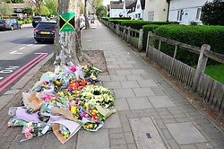 © Licensed to London News Pictures.23/04/2018<br /> ELTHAM, UK.<br /> Stephen Lawrence memorial plaque in Well Hall Road, Eltham is covered in floral tributes on the 25th anniversary of his murder.<br /> A large red heart boutique has been placed by his mum Baroness Doreen Lawrence.<br /> Photo credit: Grant Falvey/LNP