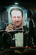 During the concert the artwork by kennardphillipps was defaced with beer in respons to Jason Williams blistering lyrics. Sleaford Mods plays live at Banksy's Dismaland. The image of PM Cameron is part of an artwork by kennardphillipps called 'Shove'. Singer Jason Williamsen often refered to the iamge of Cameron, at one point as the 'cunt in the corner'.