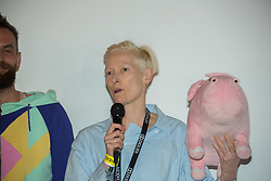 Tilda Swinton introducing a special screening of the South-Korean American Netflix film Okja at the Pilton Palais cinema tent on Day 1 of the 2017 Glastonbury Festival at Worthy Farm in Somerset. Photo date: Saturday, June 24, 2017. Photo credit should read: Richard Gray/EMPICS Entertainment