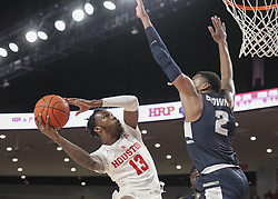 December 20, 2018 - Houston, TX, USA - Houston Cougars guard Dejon Jarreau (13) looks to shoot around the defense of Utah State Aggies forward Dwayne Brown Jr. (2) during an NCAA men's basketball game between the University of Houston and Utah State University on Thursday, Dec. 20, 2018 in Houston, TX. (Credit Image: © Scott Coleman/ZUMA Wire)
