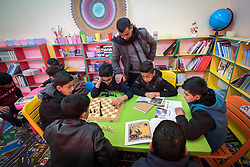 19 February 2020, Amman, Jordan: Under supervision of Nashmi, one of the school teachers, a group of boys make use of a room called 'Spaces for Creativity' at the Al Areen Secondary School for Boys in the Al Jeeza district. The room has emerged through a project by the Lutheran World Federation, whereby the school buildings and classrooms have been refurbished, and a school initiative has introduced 'Spaces for Creativity' as a way of nurturing students' creative and thinking skills. This type of learning environment is otherwise rare in Jordanian public shools. The Al Areen Secondary school teaches boys from 4th - 12th grade, most of them Jordanian, but a few also of other nationalities.