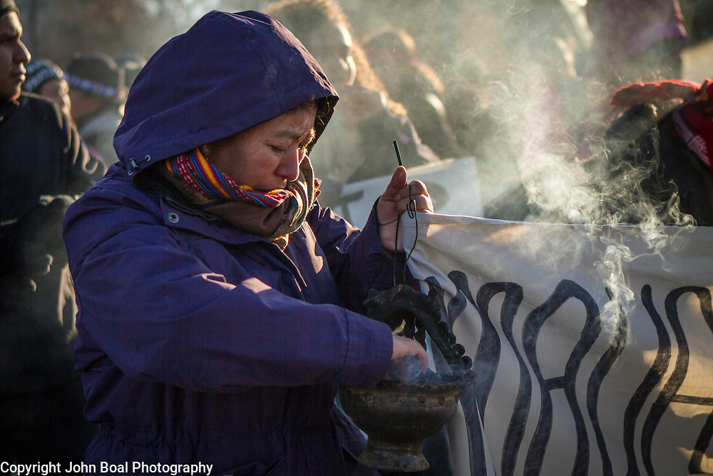 Protest and march from in front of the U.S. Capitol to the EPA, about the North Dakota Access Pipeline, as well as the effort to free Leonard Peltier.  Saturday, December 10, 2016. John Boal PhotographyLola Juan, Maya, carries an incense burner with Pom, or Copal tree resin, during a protest and march from in front of the U.S. Capitol to the EPA, about the North Dakota Access Pipeline, as well as the effort to free Leonard Peltier.  Saturday, December 10, 2016. John Boal Photography