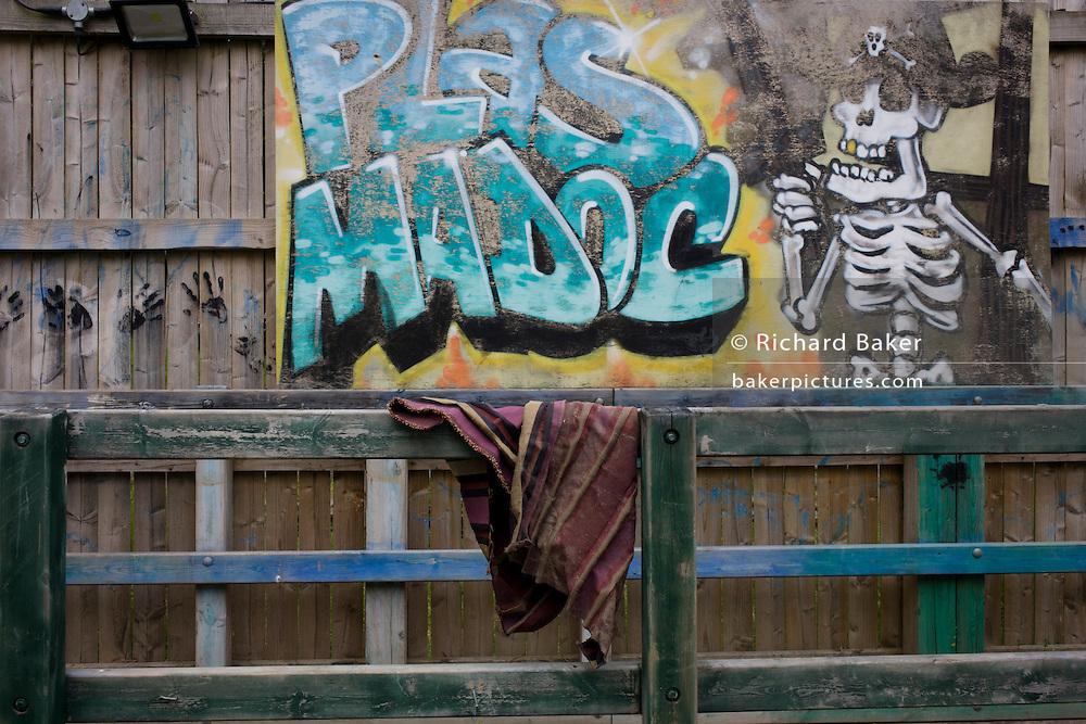 Fence graffiti in Risk averse playground called The Land on Plas Madoc Estate, Ruabon, Wrexham, Wales.
