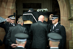 © Licensed to London News Pictures . 15/07/2016 . Bolton , UK . Greater Manchester Police Chief Constable IAN HOPKINS (l) salutes to the coffin as is it carried in to the church . The funeral of Special Constable Samantha Derbyshire at St Mary's RC Church in Horwich , Bolton. Derbyshire was struck and killed by an HGV on the M61 motorway following a collision , in the early hours of Monday 11th July 2016 . Photo credit : Joel Goodman/LNP