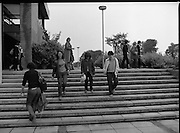 New Students At UCD.   (M94)..1979..08.10.1979..10.08.1979..8th October 1979..At the arts block of U.C.D.Belfield ,Dublin the new influx of students registered and toured the building before the got down to the serious work of study..Picture shows the new students leaving campus after registering at the college.
