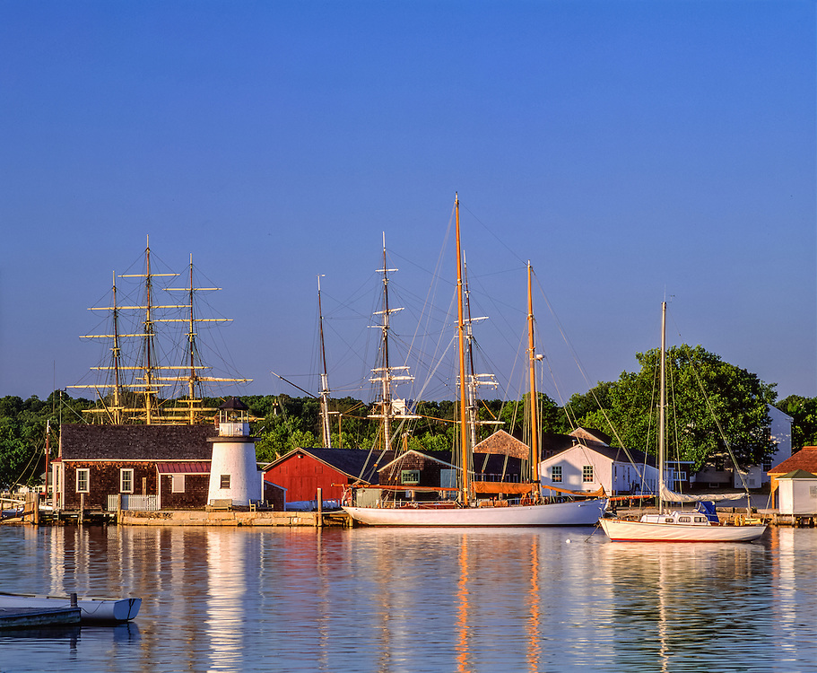 Mystic Seaport Museum, lighthouse & historic ships, reflections in Mystic River, Mystic, CT