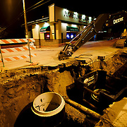 A big hole in the street in front of Kansas City's Caddy Shack bar on Third Street in the Columbus Park neighborhood.