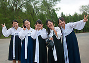 Fashion in North Korea<br /> <br /> In every corner of the earth, women love to look beautiful and keep up with the latest fashion trends. The women of North Korea are no different. Fashion is taken seriously here. But in North Korea, women do not read Elle or Vogue; they just glimpse a few styles by watching TV or by observing the few foreigners who come to visit. In the hermit kingdom, clothing also reflects social status. If you have foreign clothes it means you travel and are consequently close to the centralized power. Chinese products have inundated the country, adding some color to the traditional outfits that were made of vynalon fiber. But citizens beware, too much style means you're forgetting the North Korean juche, the ethos of self-reliance that the country is founded on! But the youth tend to neglect it despite the potential consequences.<br /> <br /> Photo shows: These girls are the daughters of North Koreans who live in Japan. They came back for a visit in Pyongyang but were asked by the officials to have a traditional hairstyle - nothing crazy like the Japanese girls like to have!<br /> ©Eric Lafforgue/Exclusivepix Media