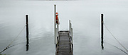 Campground dock on the Australian Coast on a moody rainy day. Licensing and Editions of 17