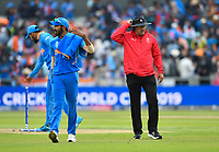 Cricket - 2019 ICC Cricket World Cup - Semi-Final: India vs. New Zealand<br /> <br /> Umpire Richard Illingworth takes the players off as rain falls, with India's Jasprit Bumrah, at Old Trafford, Manchester.<br /> <br /> COLORSPORT/ASHLEY WESTERN