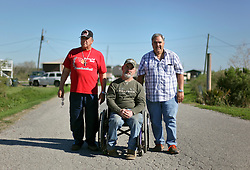 04 March 2016. Isle de Jean Charles, Louisiana.<br /> Vanishing land. First climate refugees in the USA. Isle de Jean Charles Band of Biloxi-Chitimacha Indians.<br /> L/R; Chief Albert Naquin, Chris Brunet of the tribal council and deputy Chief Boyo Billiot. The tribe has recently been awarded $52 million to resettle on higher ground as more and more of their land is consumed by erosion from the Gulf of Mexico.<br /> Photo©; Charlie Varley/varleypix.com