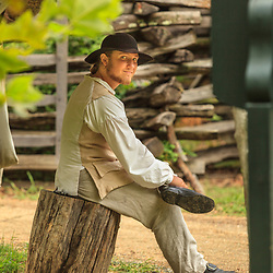 Costumed interpreter portrays a colonist at Colonial Williamsburg, VA.