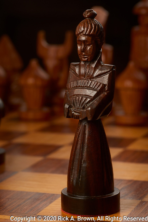 Black queen from hand-carved chess set.