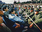 Tension mounts a week into the pro-democracy movement at Tiananmen Square in Beijing, China as soldiers and student protesters face off for the first time, separated by only a thin rope.