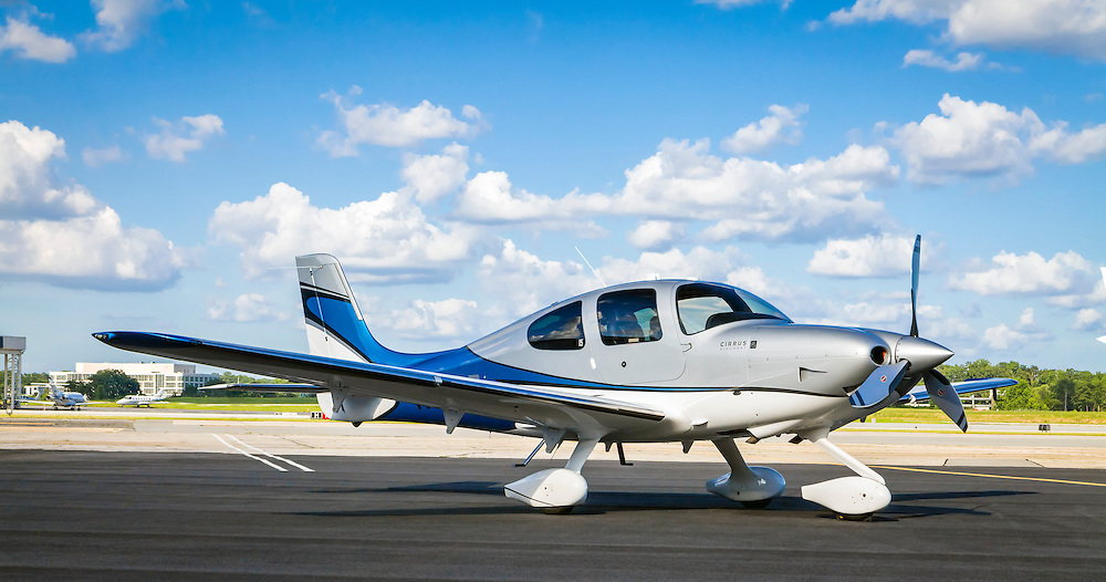 A Cirrus Vision Inspired SR22T on the ramp at Atlanta's DeKalb Peachtree Airport (PDK).