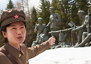 """PAEKTU, LAND OF NORTH KOREAN LEGENDS<br /> <br /> Mount Paektu volcano is considered a holy place for North Koreans. It is deemed the place of origin for them. The country's founding father Kim Il- Sung commanded anti-Japanese guerrilla in the 50's from a secret camp in this place.<br /> North Korea says his son Kim Jong-il was born there in 1942. He was actually born in Siberia, where his father had taken refuge from Japanese troops.<br /> The dear Leaders are said to have a """"mount Paektu bloodline ». A famous slogan says: « Let us all turn out in the general offensive to hasten final victory in the revolutionary spirit of Paektu! »<br /> A new probelm may erupt: when North Korea tests a nuclear weapon, specialists say the energy could trigger a volcanic...eruption in Paektu. That could be a huge disaster, killing thousands in North Korea and on the chinese side too.<br /> <br /> Photo shows:  The local guide was very happy to meet foreigners as very few go there: too far, too cold, too expensive.<br /> ©Eric Lafforgue/Exclusivepix Media"""