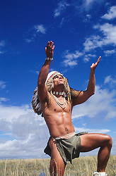 sexy shirtless American Indian man outdoors in nature