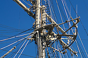 rigging and mast against blue sky
