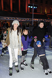 Left to right, ANNABEL NEILSON, her god daughter POPPY PIERCE, Francesca Amfitheatrof and her son Nikolai skating at Skate presented by Tiffany & Co at Somerset House, London on 22nd November 2010.