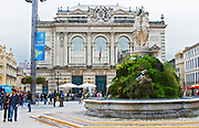 The opera and theatre on the main square. Montpellier. Languedoc. Moss covered fountain such as often found in French rural towns. France. Europe.