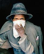 Portrait of a miner holding handkerchief to his mouth, Potosi Mine, Potosi, Eastern Cordillera, Bolivia