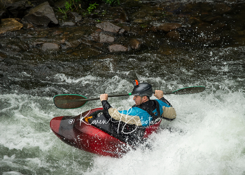 "A kayaker navigating the rapids during ""Winni River Days"" whitewater festival in Franklin on Saturday.  (Karen Bobotas/for the Laconia Daily Sun)"