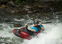 """A kayaker navigating the rapids during """"Winni River Days"""" whitewater festival in Franklin on Saturday.  (Karen Bobotas/for the Laconia Daily Sun)"""