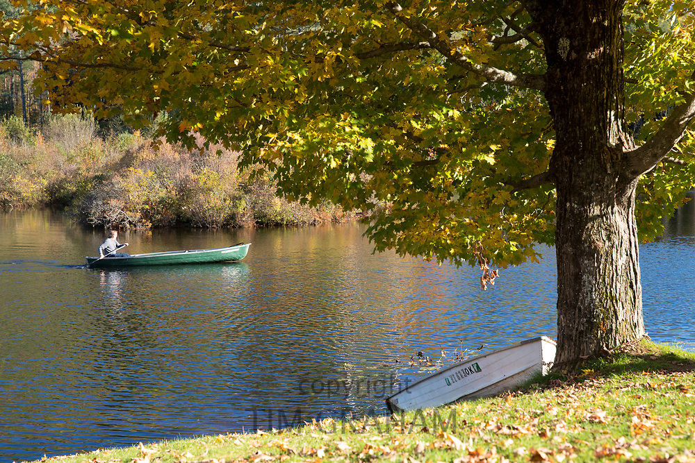 Man rowing canoe on Lake Rescue near Ludlow in Vermont, New England, USA
