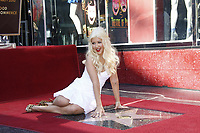 11/15/2010 Christine Aguilera poses by her Walk of Fame star