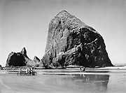 9969-6024. Haystack Rock at Cannon Beach. September 4, 1944. Bicycles.