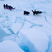 INTERNATIONAL ARCTIC PROJECT. Expedition dog team crosses a badly fractured pressure ridge on frozen Arctic Ocean.