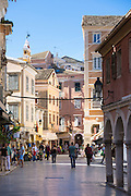 Tourists and local people in street scene in Kerkyra, Corfu Town, Greece