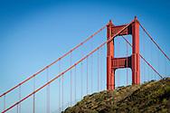 USA, California, Marin County. The Golden Gate Bridge rises above the hillside in the Marin Headlands.