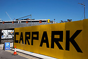 Car Park sign and the new East London Overground Line which passes above. This new line is finally open after being closed for development for more than two years.