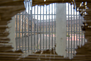 A view through a scratched window of the prison the exercise yard from inside the jail at HMP Wandsworth, London, United Kingdom. HMP Wandsworth in South West London was built in 1851 and is one of the largest prisons in Western Europe. It has a capacity of 1456 prisoners. (Picture by Andy Aitchison)