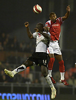 Photo: Daniel Hambury.<br />Fulham v Charlton Athletic. The Barclays Premiership. 16/10/2006.<br />Fulham's Papa Bouyba Diop and Charlton's Marcus Bent compete for the ball.