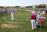 Back of the 16th. Victor Dubuisson (FRA) plays to the par 3 during Round Two of the 2015 Alstom Open de France, played at Le Golf National, Saint-Quentin-En-Yvelines, Paris, France. /03/07/2015/. Picture: Golffile   David Lloyd<br /> <br /> All photos usage must carry mandatory copyright credit (© Golffile   David Lloyd)