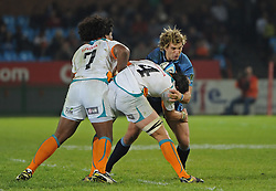 PRETORIA, South Africa, 28 May 2011. Wynand Olivier of the Bulls is tackled by Francois Uys and Ashley Johnson of the Cheetahs during the Super15 Rugby match between the Bulls and the Cheetahs at Loftus Versfeld in Pretoria, South Africa on 28 May 2011..Photographer : Anton de Villiers / SPORTZPICS