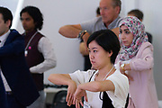 Participants captured during the session: Morning Tai Chi at the World Economic Forum - Annual Meeting of the New Champions in Tianjin, People's Republic of China 2018.Copyright by World Economic Forum / Greg Beadle