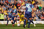 Luke Garbutt of Oxford United is tackled during the EFL Sky Bet League 1 match between Oxford United and Wycombe Wanderers at the Kassam Stadium, Oxford, England on 30 March 2019.