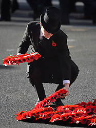 Wreaths are laid during the annual Remembrance Sunday Service at the Cenotaph memorial in Whitehall, central London, held in tribute for members of the armed forces who have died in major conflicts.