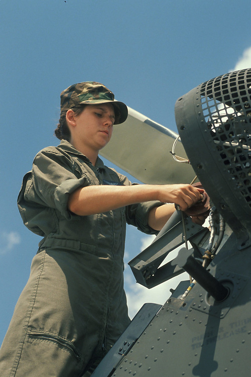 Anglo women serving in military as plane maintenance engineer.  ©Bob Daemmrich