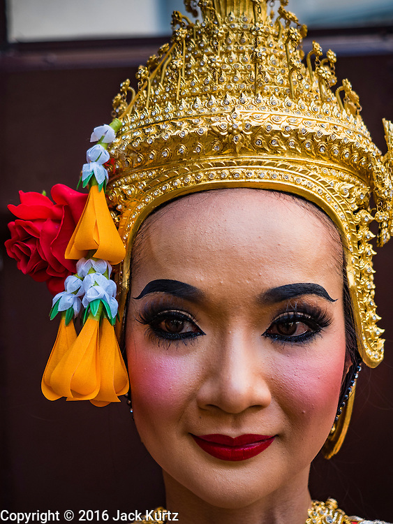"""19 DECEMBER 2016 - BANGKOK, THAILAND: A Thai classical dancer at the """"Spirit Appeasing"""" Ceremony held for the Royal Chariots at the Bangkok National Museum. The chariots will be used to take the body of Bhumibol Adulyadej, the Late King of Thailand, and members of the Royal funeral cortege to the cremation site on Sanam Luang for His Majesty's cremation. This will be the first cremation of a Thai King since 1950, when King Bumibol's brother, Rama VIII, Ananda Mahidol, was cremated. The design of the royal crematorium is based on Buddhist cosmology, with the main peak of Mount Sumeru (also known as Meru in Hindu cosmology) at center and eight other peaks signifying the levels of the universe. The crematorium will be decorated with mythical creatures such as garuda, angels, and Himmapan Forest creatures. The structure and funeral pyre will stand just over 50 meters tall. The exact date of the King's cremation has not been set yet but is expected to be late next year.     PHOTO BY JACK KURTZ"""