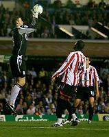 Photo: Steve Bond.<br /> Birmingham City v Sunderland. The FA Barclays Premiership. 15/08/2007. Colin Doyle (L) gathers safely as Stern John (R) closes in