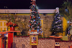 The tree decorated by Juliana's Bake Shop takes first place with its minature model of Juliana's Bake Shop.  Frenchtown Civic Organization/French Heritage Museum presents its 3rd Annual Festival of Lights Christmas Tree Competition in Frenchtown.  St. Thomas, USVI.  11 December 2016.  © Aisha-Zakiya Boyd